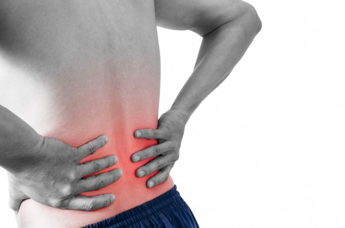 Man having a backache isolated on white with clipping path.